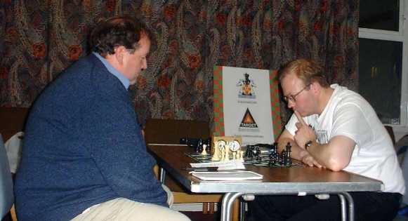 David Houston, with White, playing against tournament winner Steve Scannell in Round 7. The game was drawn.