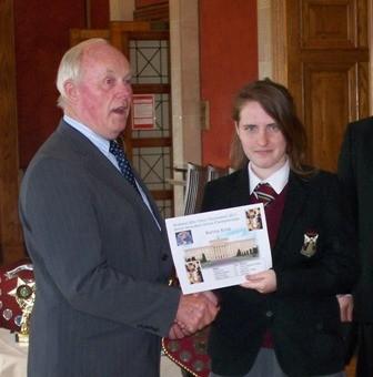 Karina Kruk the Senior Champion receives prize from Kieran McCarthy MLA