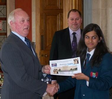 Radhika Gupta receives award from Kieran McCarthy