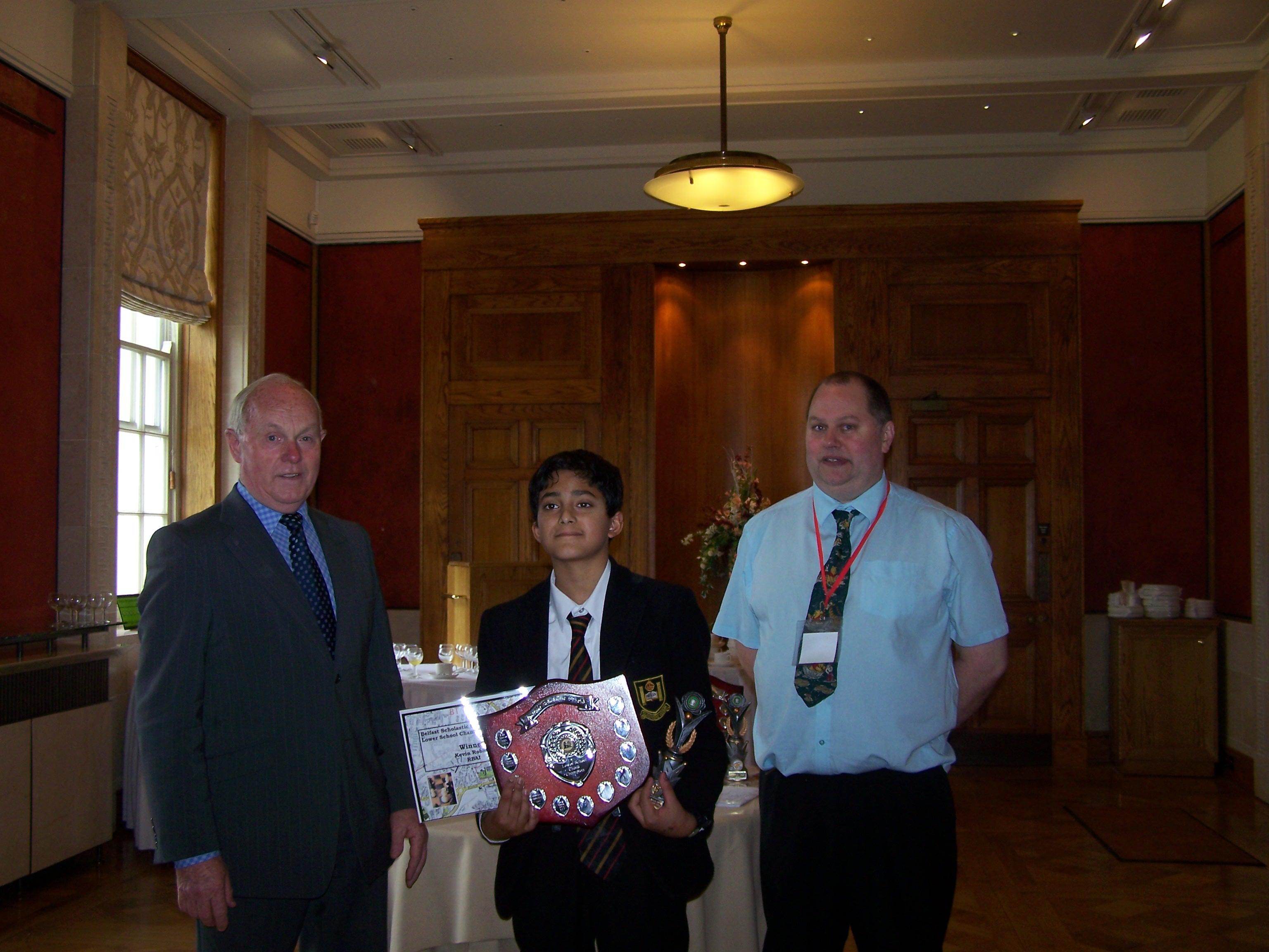 Kieran McCarthy MLA awards Kevin Robbin with winners shield