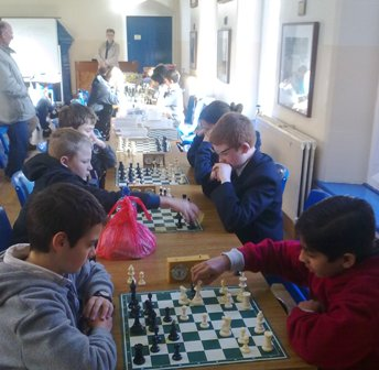 Eoghan Turkington playing Raghav Gupta and in the background Joel Dawson under 14 Champion plays Matthew Gray
