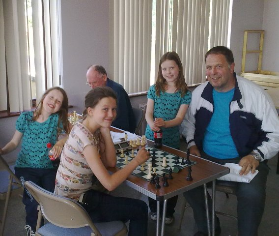 The Eachus Family Enjoying Chess