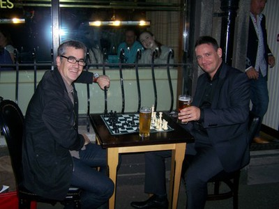 Friends enjoying a drink and a game