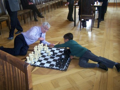 Brian Wilson and Raghav playing the large chess set